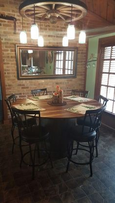 Wagon wheel chandelier and whiskey barrel table that me and my husband built. Love it !!
