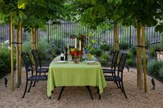 Appropriate plants, candleholders, table linens and tableware can add your personality to your outdoor space.