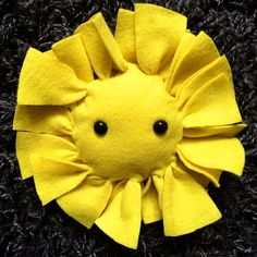 No Sew tie sun taggie toy. To make it baby safe sew on felt eyes instead of beads.