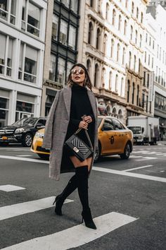 Pam Hetlinger, founder and editor of The Girl From Panama, shows the easiest way to style over the knee boots.