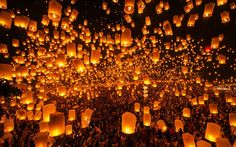 A spectacular scene unfolds every year at the Yi Peng Festival in Chiang Mai, northern Thailand, when thousands of candle-lit paper lanterns are released into the sky.