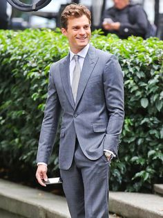 Star Tracks: Tuesday, October 14, 2014   BUSINESS SEXY   Navy just wouldn't do! In a suit and tie that match his character Christian Grey's last name, Jamie Dornan gets ready for reshoots Monday on the Vancouver, Canada, set of Fifty Shades of Grey.