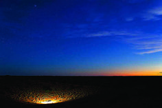 Kielie Krankie water hole at sunset in the Kgalagadi Transfrontier Park, Kalahari Desert, South Africa: Photographed by Shane Saunders  (Cape Town, RSA)