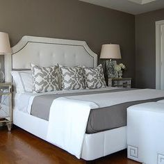 I love the white and grey bedding.  I would add yellow accent decor :)