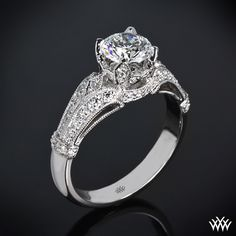 """Vintage in style, the """"Sarah's Surprise"""" Diamond Engagement Ring recalls the beauty of times past. Sparkling with 50 gorgeous A CUT ABOVE® Hearts and Arrows Diamond Melee (0.33ctw; F/G VS), this ring is sure to steal her heart."""