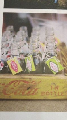 Coke crate and bottles as escort cards