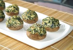 Spinach Stuffed Mushrooms is an easy appetizer for parties. Just fill the mushrooms with spinach, cream cheese, breadcrumbs and spices. Bake and serve the Spinach Stuffed Mushrooms as a simple starter. Spinach Appetizers, Appetizers For Party, Appetizer Recipes, Appetizer Ideas, Stuffed Mushroom Caps, Spinach Stuffed Mushrooms, Stuffed Mushroom Recipes, Recipe For Stuffed Mushrooms, Vegetarian Recipes