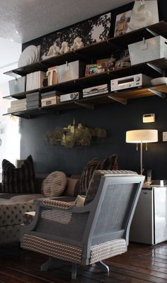 Create custom Elfa shelves by staining custom-cut wood at Home Depot.