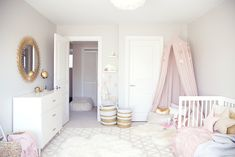 A chic toddler room inspired by Pantone's color of the Year. It pairs rose quartz with gold accents and whimsical details like a play tent and a dress-up corner perfect for a little girl's bedroom. Baby Bedroom, Nursery Room, Bedroom Decor, Room Baby, White Nursery, Bedroom Girls, Trendy Bedroom, Nursery Themes, Nursery Ideas