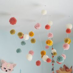 Pom Pom Garland, Ceiling Affair from HumbleHouse Handmade $40 - great colors