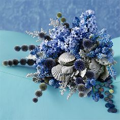 Tentacles of echinops extend from a bouquet of artemisia, grape hyacinths, dusty miller, hyacinths and seashells—just the thing for a marrying mermaid, Claire Bean, Westhampton, NY, clairebean.com.