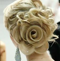 This Rose bun in her hair is awesome.