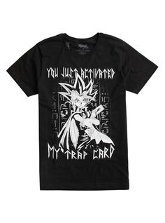 "Black T-shirt from <i>Yu-Gi-Oh!</i> with a large Yami Yugi illustration deign on front featuring those dreaded words, ""You just activated my trap card!"" Oh, snap.<br><ul><li style=""list-style-position: inside !important; list-style-type: disc !important"">100% cotton</li><li style=""list-style-position: inside !important; list-style-type: disc !important"">Wash cold; dry low</li><li style&#x..."