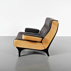 Eugenio Gerli Leather Easychair for Tecno, circa 1960 | From a unique collection of antique and modern armchairs at https://www.1stdibs.com/furniture/seating/armchairs/