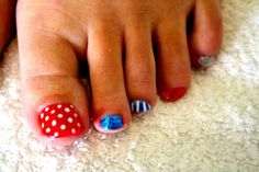 CND Shellac toes in Wildfire with Winter Blue Glitter and polka dots.  #cndshellac #nailart #nails
