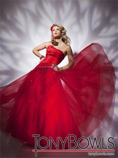 Tony Bowls Paris    The fabric in this style is Taffeta and Tulle  Matching shawl included    Our Price: $550.00