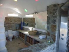 I was looking for examples of greek bathrooms and this came up - interesting combination of the stone (which we have), and the white plaster effect