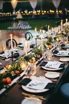 Sleek and modern tablesetting with gold cutlery and black and white table runner.