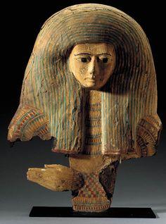 AN EGYPTIAN WOOD MASK LATE NEW KINGDOM TO THIRD INTERMEDIATE PERIOD, 1196-712 B.C.