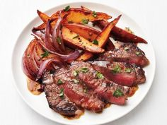 Steak with Beer Sauce and Sweet Potatoes - Put your favorite lager to work in this dish. Simmering a half-cup of lager-style beer (drink the rest!) with just a touch of Dijon mustard will result in a perfect light steak sauce with plenty of flavor. Rounding out your steak-and-potatoes meal, sweet potato fries add a nice touch of festive fall color. http://www.foodnetwork.com/recipes/food-network-kitchen/steak-with-beer-sauce-and-sweet-potatoes-3580523