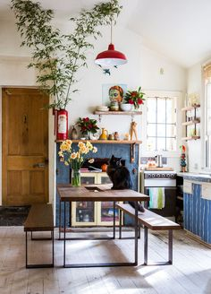 Love the feel of this kitchen- may be a bit too artsy-relaxed in that there aren't a lot of cabinets or shelves, but it's still awesome.