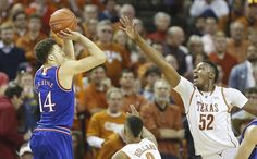 Kansas guard Brannen Greene (14) pulls up for a three as he is defended by Texas forward Myles Turner (52) during the second half, Saturday, Jan. 24, 2015 at Frank Erwin Center in Austin, Texas. Photo by Nick Krug