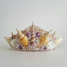 Do you secretly wish you were a mermaid? Do you love the beach and the salt life? If so, this Mermaid Crown is just for you! Made of natural seashells, this crowns simple elegance is great for weddings, festivals, costumes, gifts, and more! Each Crown is handmade, and a one of a kind