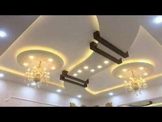 About this video shown /gypsum ceiling beautiful design Down Ceiling Design, Drawing Room Ceiling Design, Simple False Ceiling Design, Plaster Ceiling Design, Interior Ceiling Design, Gypsum Ceiling, House Ceiling Design, Ceiling Design Living Room, Bedroom False Ceiling Design