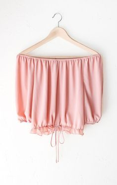 - Description Details: Off-the-shoulder half sleeves crop top in blush featuring an elasticized neckline & self tie accent on the ruffled elasticized hem. Flowy, relaxed fit. Measurements (Size Guide)