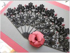Black paper lace fan.