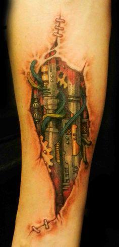 #Bio-mechanical #rippedskin #tattooart #tattoodesign