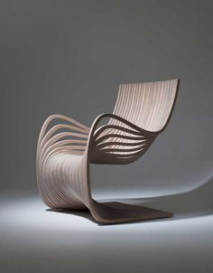 This gracefully curving wooden chair is one of the latest pieces exquisitely crafted by designer Alejandro Estrada. The Pipo Chair, produced for sale by Gu design, Chair with Sexy Curves Constructed Entirely from Two Pieces of Plywood Unique Furniture, Contemporary Furniture, Furniture Stores, Funky Furniture, Cheap Furniture, Office Furniture, Bedroom Furniture, Furniture Cleaning, Furniture Movers
