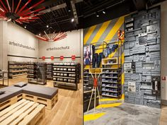 The stores for ENGELBERT STRAUSS present the world of workwear from a completely new perspective. Rack Design, Display Design, Visual Merchandising, Workwear Store, Store Layout, Floor Layout, Retail Store Design, Store Interiors, Retail Interior