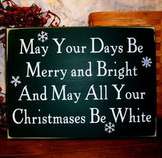 Christmas Sign May Your Days Be Merry and Bright Painted Wood Snowflakes. $24.00, via Etsy.
