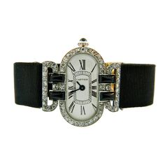Cartier Lady's Platinum, Diamond and Onyx Art Deco Wristwatch | From a unique collection of vintage wrist watches at http://www.1stdibs.com/jewelry/watches/wrist-watches/
