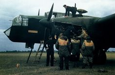 "RAF mechanics are checking one of the engines of an Armstrong Whitworth ""Whitley"" Mk.V medium bomber as her crew looks on. The Whitley . Aircraft Photos, Ww2 Aircraft, Military Aircraft, Lancaster Bomber, Ww2 Photos, Ww2 Planes, Vintage Airplanes, Battle Of Britain, Royal Air Force"
