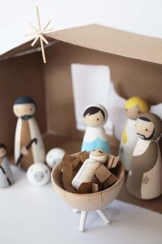This DIY nativity set with wood peg dolls is budget friendly and not too kitschy. If you love modern, this scene is for you! Fun for kids.