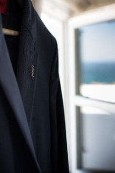 Groom's dark blue suit. Wedding in Skyros island