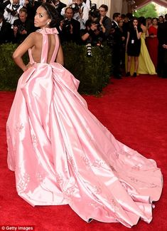 In the pink: The Scandal star's dramatic gown looked extremely heavy, and she off-set the ...