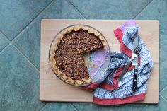deeply pecan pie; made with out corn syrup, but has molasses, maple syrup, and brown sugar for sweetness and egg yolks, butter, and heavy cream for richness