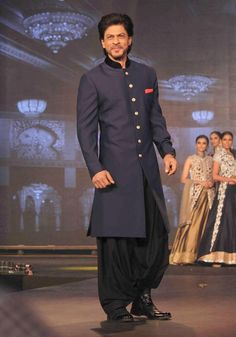 We bring to you the latest sherwani trends worn by top Bollywood celebrities. Mesmerize your bride with these dapper groom looks to die for. Blue Sherwani, Sherwani Groom, Wedding Sherwani, Mens Sherwani, Punjabi Wedding, Mens Indian Wear, Indian Groom Wear, Indian Men Fashion, Groom Fashion
