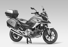 Honda NC700X. Inexpensive, not too powerful, and storage space out the wazoo. And up to 60+ mpg doesn't sound too shabby either...