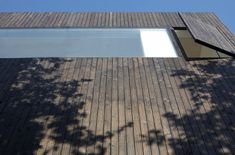 timber cladding to opening panel
