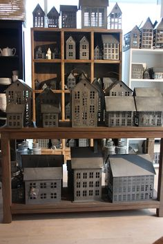 tin house lanterns  - wish I knew where to get some in the States; they seem to be Scandinavian.