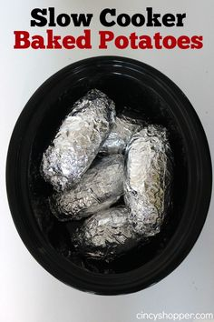 Slow Cooker Baked Potatoes Recipe. Yes... you can make your baked potatoes in the crock-pot. Load them up with your favorite toppings for a meal. YUM!
