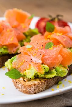 A very unusual & healthy breakfast recipe; Cold smoked trout with crushed avocado on sourdough toast with slow roast plum tomatoes