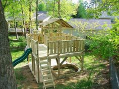 Install a backyard play structure with two stories, ladders, and tube slide from a kit. Description from landscapinggallery.info