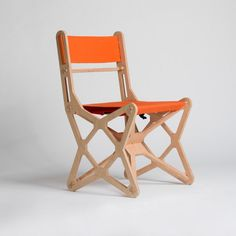 """CHAIR ELECTRON BY KONSTANTIN ACHKOV.  """"The chair is made of 18mm beech plywood cut with a CNC router. Each part is assembled like a puzzle without glue or screws. Plywood joints have a click pin shape. The tight textile is waterproof and has uv protection. The elements of the chair are flat-pack assembly. The chair is very stable, because the middle has a three-dimensional x-form structure. http://mocoloco.com/vote/chair-electron-by-konstantin-achkov/"""