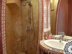 Tiled shower walls - looks quite nice in front of the more plain walls in the background