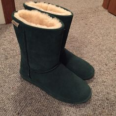 Fuzzy boots size 8 Brand new Emerald green fuzzy boots. Very similar brand to uggs. Bearpaw Shoes Winter & Rain Boots